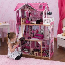 Kidkraft Amelia Dollhouse is an elaborately decorated wooden dolls house with detailed internal furnishings including 14 play pieces