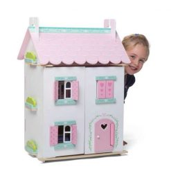 Le Toy Van Sweetheart Cottage Dolls House is a wonderfully painted and decorated wooden dollhouse with hearts and flowers motif