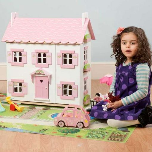 Le Toy Van Sophie's Dolls House is a beautiful white wooden dolls house with a pink sparkling roof and working window & shutters