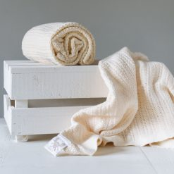 Abeille Cellular Baby Blanket Cream, made from super soft cotton in an all-important cellular weave that aids temperature regulation,