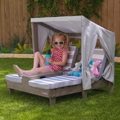 Kidkraft weather resistant double chaise with cupholders and a grey canopy