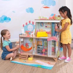 Kidkraft Ferris Wheel Fun Beach House Dollhouse is a two sided wooden post and beam-styled doll house, with a real rotating Ferris wheel